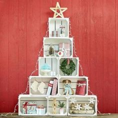 There are 9 of our versatile wooden apple crates in this high Christmas Tree arrangement which makes a seasonal retail display. Unique Christmas Decorations, Wooden Christmas Trees, Noel Christmas, Holiday Decor, Christmas Windows, Christmas Crafts, Christmas Grotto Ideas, Christmas Booth, Unique Christmas Trees