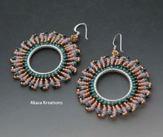 Sterling Silver Seed Beaded Hoop earrings created by Aria Vaillancourt. Pink, Gold, Black, Turquoise. $20.  https://www.etsy.com/listing/193483013/passion-beaded-sterling-silver-hoop?ref=shop_home_active_2