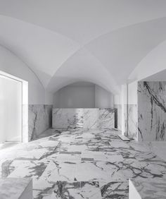 Grey marble | tapestry museum by Portuguese studio CVDB Arquitectos.