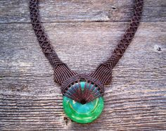 Handmade Micro Macrame Necklace in Brown with Jade Donut Stone. $60.00, via Etsy.