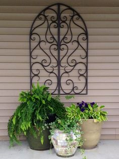 Use wall art to fill empty space outdoors. This 4ft piece was only $40 from Kirkland's.