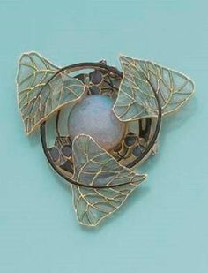 AN ART NOUVEAU OPAL AND ENAMEL PENDANT BY RENÉ LALIQUE. Consisting of plique-à-jour enamel leaves and flowers, with a cabochon opal centre, mounted in yellow gold, circa 1900. by hester