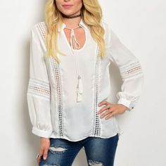 "MAKE AN OFFER Beautiful top in white with perforated details and tassel tie at neck. Irresistible!  100% polyester. Small measures L29"" B38"" W36"" S (2) M(1)  L (2) No PayPal. No trades. Price firm unless bundled. Tops Tunics"