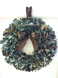 """Don't throw those old uniforms away!! Get your very own custom military wreath made out of your hubby's old uniforms! **I do not provide uniforms! If you do not have an old uniform, I can do my best to """"duplicate"""" the colors!** Since I am a military spouse and I appreciate ALL branches and their ..."""