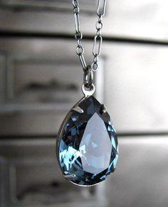 Cornflower blue crystal teardrop pendant set in antiquated silver bezel