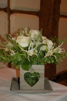 Wooden Heart Table centre arrangement with loose natural flowers
