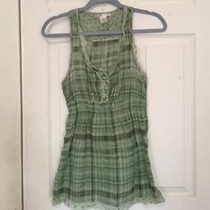 Green plaid peasant tunic top! Light and summery, this green plaid tunic top has floral detailing and is a racer back. Falls just past my hips making it great when paired with skinny capris while you're on vacation! Charlotte Russe Tops Tunics