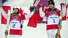 Canada's Alex Bilodeau, gold medallist, right, and silver medallist Mikael Kingbury celebrate their wins following the finals in the men's moguls freestyle skiing event at the Sochi Winter Olympics in Krasnaya Polyana, Russia, Monday, Feb. 10, 2014. (Jonathan Hayward / THE CANADIAN PRESS)