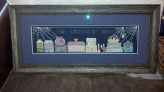 The Witch's Pantry cross stitch, finished and framed.
