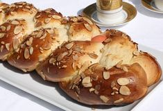 This tsoureki recipe, a sweet yeast bread made of eggs, milk, and butter, is a staple during Greek Easter. Greek Easter Bread, Greek Bread, Easter Bread Recipe, Easter Recipes, Easter Food, Greek Sweets, Greek Desserts, Greek Recipes, How To Cook Eggs