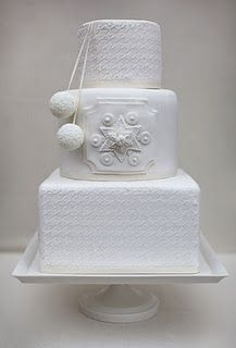 This white winter wedding cake reminds me of a sweater I wore when I was a little girl.  Loved it then.  Love this now.