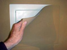 This secret wall safe from ConsoleVault includes a magnetic cover that can be painted to match your wall color. This can work well in low traffic areas, utility closets, garages, etc. Secret Walls, Secret Rooms, Hidden Spaces, Hidden Rooms, Secret Hiding Places, Panic Rooms, Secret Storage, Hidden Storage, Wall Safe
