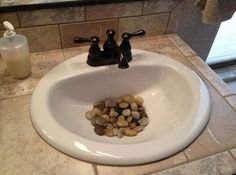 River rocks in the bathroom sink. A little feng shui but a neat way to decorate … River rocks in the bathroom sink. A little feng shui but a neat way to decorate too! Spa Bathroom Decor, Asian Bathroom, Bathroom Ideas, Feng Shui Design, Bathroom Sink Cabinets, Feng Shui Bedroom, Creation Deco, Home And Deco, Decorating Tips