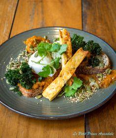 SMASHED PUMPKIN with crispy kale eggs, poached eggs, haloumi, coriander, dukkah and pumpkin seeds on organic quinoa and soya toast