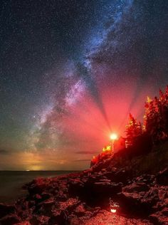 The Milky Way stretches across the sky next to Bass Harbor Lighthouse in Acadia National Park. Photographing our night sky at any lighthouse is difficult. This spot is especially demanding due to the intense red light coming from the tower's fourth order All Nature, Amazing Nature, Beautiful Sky, Beautiful World, Photos Voyages, Milky Way, Belle Photo, Nature Photos, Night Skies