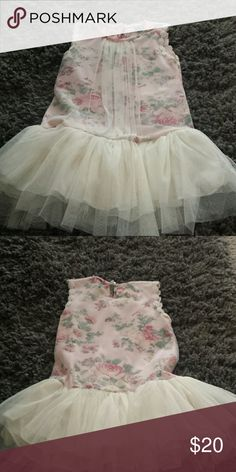 Children's boutique dress Beautiful floral dress with applique around the arm area. Dazzling soft yellow tulle bottom. I purchased from a boutique on Instagram. The dress is too small for my older daughter and too big for my younger one. Dresses Casual