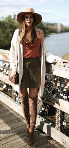 #fall #outfits women's brown leather hat, brown spaghetti strap top, white cardigan, brown mini skirt, pair of brown knee high boots, and brown leather cross-body bag outfit