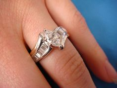 1 CT. LADIES ENGAGEMENT RING MARQUISE AND BAGUETTES 4.9 GRAMS SIZE 7 1/2