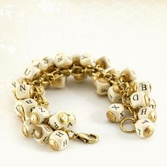 Alphabet Bracelet by Lenora Dame: Wooden beads and oxidized gold plate! $80
