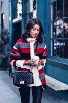 Comfort isn't only exclusive to soft sweatpants and oversized sweaters and that's proven in this post. This fashion blogger wore a striped jacket, cream colored turtleneck, leather pants and edgy, statement boots. Together, this outfit is rocker-chic.