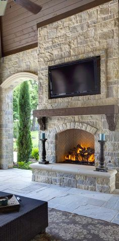 OUTDOOR FIREPLACE AREA - outdoor fireplace mantle do NOT like the frame around tv Fireplace trim is nice small hearth