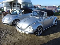Heres two twin convertible bugs owned by twins! The 2005 one is Garys who is Glens twin brother, who owns the 1977. Here they both are at VW Action 2009.