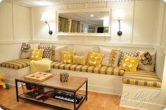 Love these pillows in this gorgeous basement sitting area.