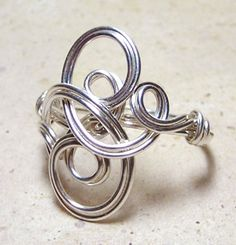 Wire scroll ring