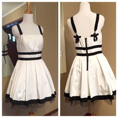 Forever 21 white party dress with black bows Ok this is adorable!! Black tool underneath gives the dress volume in all the right places.  Nice black detail including bows on the back straps. Excellent condition size med fully lined Forever 21 Dresses
