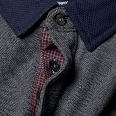 Fred Perry's Long Sleeve Woven Collar Polo offers an update on an iconic style from the label's past. Constructed from a traditional cotton pique, the polo features the addition of a textured woven collar and discrete gingham lining under the concealed button placket. 100% Cotton Contrasting Woven Collar Button Detail Cuffs Embossed Laurel Wreath Logo Concealed Contrasting Button Placket