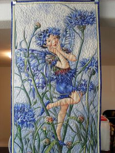 Beautifully  machine quilted flower fairy panel made into a wall hanging.