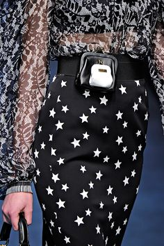 Dolce & Gabbana love the skirt and blouse. What is going on with the belt change purse?
