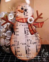 Snowman ornament made from sheet music.