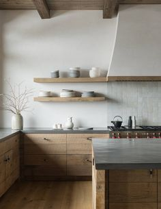 Rustic and Scandinavian styles rolled into one in the minimal kitchen [From: Pearson Design Group]...