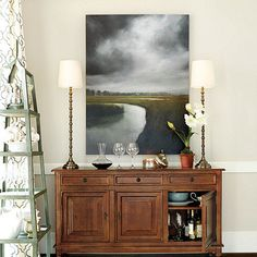 In this moody, realistic landscape by artist James McLaughlin Way, you can almost feel the storm clouds gathering over the salt marsh. Stretched canvas version.