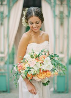 Gorgeous Coral, Peach, and Green Spring Bouquet | Peaches & Mint Photography | A Blooming Spring Wedding full of Lush Flowers in Peach and Fresh Green - http://heyweddinglady.com/blooming-spring-wedding-full-of-lush-flowers/