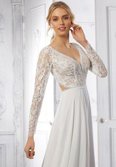 The A-line wedding dress has a lace bodice with a v-neckline, long sleeves, and heyhole back with a chiffon skirt. Stunning Wedding Dresses, Bridal Wedding Dresses, Mori Lee, Chiffon Skirt, Lace Bodice, Dream Dress, Bride, Formal Dresses, Collection
