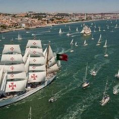 "The ""Tall Ships Race, 2012"" with our Sagres Ship in first plan. At Tagus  River meeting the Atlantic Ocean, Lisbon, Portugal."