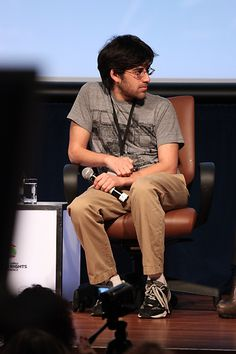 Activist Aaron Swartz listens to a representative from Google at the Silicon Valley Human Rights Conference