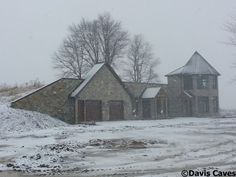 A great winter-time shot of a recently completed earth sheltered home (built by davis caves)