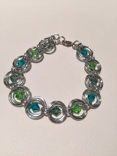 A personal favorite from my Etsy shop https://www.etsy.com/ca/listing/270633870/green-and-blue-shades-swarovski-crystal