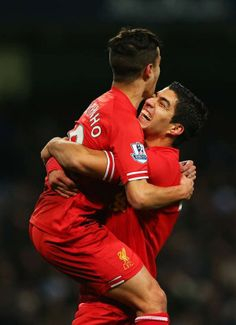 Coutinho and Suarez celebrate against Man Citeh 12/26. The 1 in the 2-1 loss
