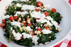 Grilled kale salad with yogurt dressing and hazelnuts