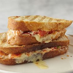 Lobster Grilled Cheese Sandwich - Lobster salad tossed with Farmhouse Mayo and scallions and grilled with Gruyere cheese. We're in heaven!