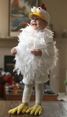 Katie Bohren, 23-months-old, tries on her chicken Halloween costume made by her mom, Tracy, in Clovis, California.