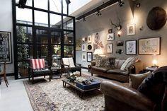 BRICKS Studio: endüstriyel tarz tarz Oturma Odası