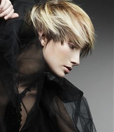 A short blonde straight feathered coloured hairstyle by Karine Jackson