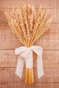 In the 14th Century brides would often carry wheat to symbolize fertility or the flower girls would throw the wheat to also symbolize fertility
