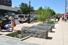 Integrated seatwalls and stormwater planters. Parker Rodriguez