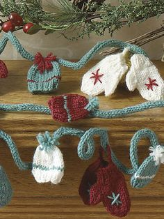 Ravelry: Mini Mitt & Hat Garland pattern by Diane Zangl